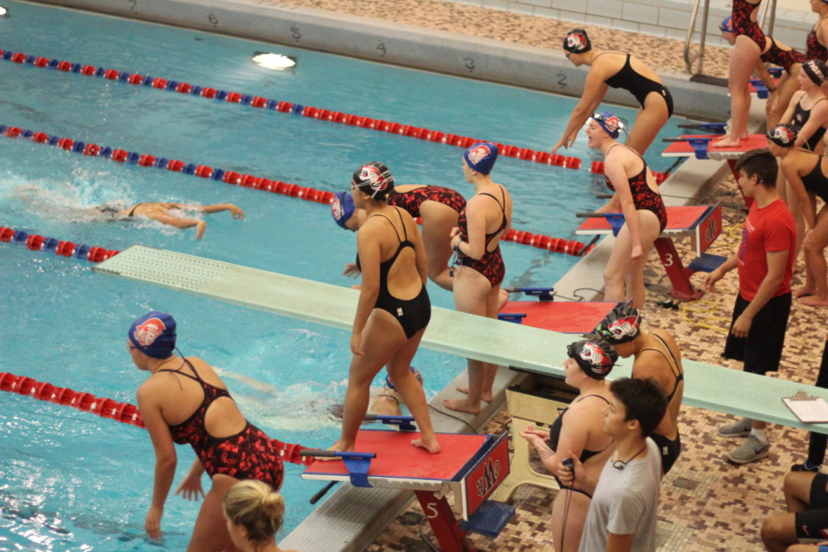 The swim team participating in a meet earlier this month