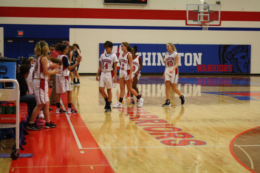 Girls walking to the sideline during a basket ball game in December.