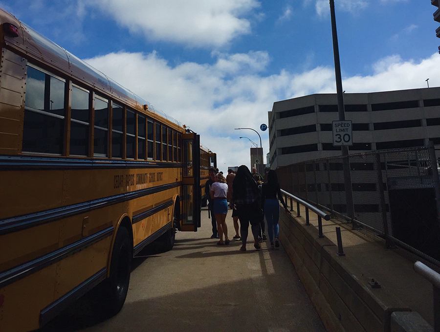 Students get onto a Cedar Rapids Community school bus. Photo by Gabe Greco.